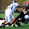 Fairview High School's Joe Quinn (25) is tackled by Pomona High School's Dustin Conley (34) and Jamar Herbert (13) during the class 5A State Semifinals at Recht Field in Boulder, Saturday, Nov. 28, 2009. <br /> <br /> KASIA BROUSSALIAN /THE CAMERA