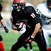 Fairview High School's Tucker Tharp (11) protects the ball as Pomona High School's Cory Mager (72) comes in from behind during the class 5A State Semifinals at Recht Field in Boulder, Saturday, Nov. 28, 2009. <br /> <br /> KASIA BROUSSALIAN /THE CAMERA