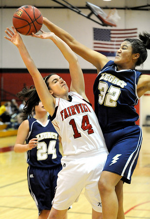 Fairview High School senior Rori Flanagan get her shot rejected by Legacy's Sade Akindele during a game against Legacy High School on Friday, Feb. 4, at Fairview High School. Fairview lost 62-51.<br /> Jeremy Papasso/ Camera