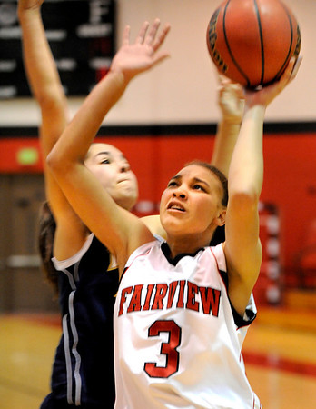 Fairview High School senior Carlee Lough shoots the ball during a game against Legacy High School on Friday, Feb. 4, at Fairview High School. Fairview lost 62-51.<br /> Jeremy Papasso/ Camera