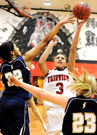 Fairview High School senior Carlee Lough shoots the ball over Legacy's Sade Akindele during a game against Legacy High School on Friday, Feb. 4, at Fairview High School. Fairview lost 62-51.<br /> Jeremy Papasso/ Camera