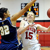Fairview High School senior Kristen Narum tries to lay the ball up past Legacy's Sade Akindele during a game against Legacy High School on Friday, Feb. 4, at Fairview High School. Fairview lost 62-51.<br /> Jeremy Papasso/ Camera