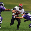 """Ben Meyer of Fairview, tries to get past Ian Flemming (38) of Arvada West.<br /> For more photos of the game, go to  <a href=""""http://www.dailycamera.com"""">http://www.dailycamera.com</a>.<br /> Cliff Grassmick / October 9, 2010"""