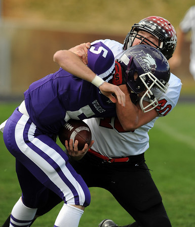 """Arvada West quarterback is sacked by Max Newey of Fairview.<br /> For more photos of the game, go to  <a href=""""http://www.dailycamera.com"""">http://www.dailycamera.com</a>.<br /> Cliff Grassmick / October 9, 2010"""