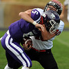 "Arvada West quarterback is sacked by Max Newey of Fairview.<br /> For more photos of the game, go to  <a href=""http://www.dailycamera.com"">http://www.dailycamera.com</a>.<br /> Cliff Grassmick / October 9, 2010"