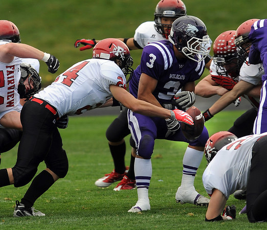 "Colin Brown, left of Fairview, helps create a fumble by  Alex Turner of Arvada West on Saturday.<br /> For more photos of the game, go to  <a href=""http://www.dailycamera.com"">http://www.dailycamera.com</a>.<br /> Cliff Grassmick / October 9, 2010"