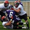 "Brandon Boyle, bottom left, and Max Newey of Fairview, bring down Isaac Fairbairn of Arvada West.<br /> For more photos of the game, go to  <a href=""http://www.dailycamera.com"">http://www.dailycamera.com</a>.<br /> Cliff Grassmick / October 9, 2010"
