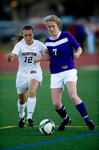 Fairview's Daphanee Morency (left) and Boulder's Lauren Getty fight for the ball during the game at Fairview High School in Boulder, Thursday, April 8, 2010.