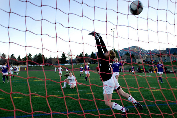 Boulder's Hannah Chase misses a goal by Fairview's Keelyn Arnold during the game at Fairview High School in Boulder, Thursday, April 8, 2010.