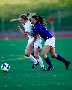Fairview's Annie Stuller (left) and Boulder's Lauren Robb fight for possession of the ball during the game at Fairview High School in Boulder, Thursday, April 8, 2010.