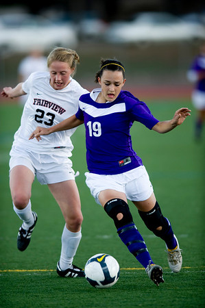Fairview's Annie Stuller (left) dribbles the ball while Boulder's Katlyn Lokay defends during the game at Fairview High School in Boulder, Thursday, April 8, 2010.