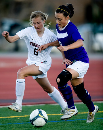 Fairview's Nikola Machalek (left) keeps the ball away from Boulder's Katlyn Lokay during the game at Fairview High School in Boulder, Thursday, April 8, 2010.