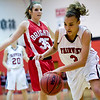 Fairview's Carlee Lough (right) dribbles past Brighton's Heather Guilliams during their game at Fairview High School in Boulder, Jan. 14, 2009. <br /> KASIA BROUSSALIAN