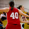Fairview's Casey Thayer (behind) passes around Brighton's Jenna Sandoval during their game at Fairview High School in Boulder, Jan. 14, 2009. <br /> KASIA BROUSSALIAN