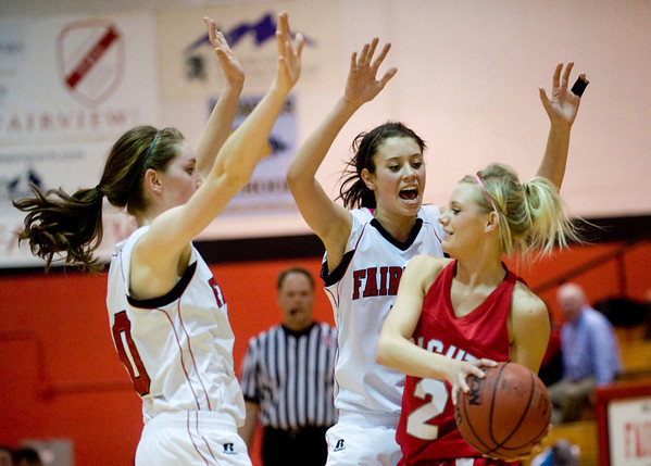 Fairview's Caitlin Higgins (left) and Maya Singer defend as Brighton's Kendra Moriarty looks for an open pass during their game at Fairview High School in Boulder, Jan. 14, 2009. <br /> KASIA BROUSSALIAN