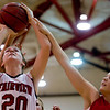 Fairview's Caitlin Higgins shoots as Brighton defends during their game at Fairview High School in Boulder, Jan. 14, 2009. <br /> KASIA BROUSSALIAN