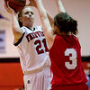 Fairview's Casey Thayer (back) shoots over Brighton's Jordanne Kniss during their game at Fairview High School in Boulder, Jan. 14, 2009. <br /> KASIA BROUSSALIAN