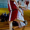Fairview's Maya Singer (right) shoots as Brighton's Jenna Sandoval defends during their game at Fairview High School in Boulder, Jan. 14, 2009. <br /> KASIA BROUSSALIAN
