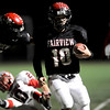 Fairview's quarterback Ben Schumacher (10) runs out of bounds after a scramble during the game against Grand Junction Central's at Recht Field  in Boulder, Friday, Nov. 6, 2009. <br /> KASIA BROUSSALIAN / THE CAMERA