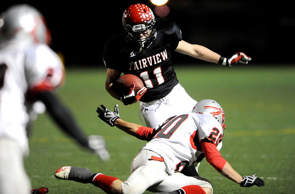 Fairview's Tucker Tharp (11) dodges over Grand Junction Central's Mike Ruble (20) before being taken down during the game at Recht Field  in Boulder, Friday, Nov. 6, 2009. <br /> KASIA BROUSSALIAN / THE CAMERA