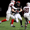 Fairview's Daniel Flora (86) is tackled by Grand Junction Central's Devon Wolff (58) while Mike Ruble (20) defends during the game at Recht Field  in Boulder, Friday, Nov. 6, 2009. <br /> KASIA BROUSSALIAN / THE CAMERA
