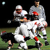 Fairview's Jeff Cunningham (40) takes down Grand Junction Central's Josh Buniger (11) during the game at Recht Field  in Boulder, Friday, Nov. 6, 2009. <br /> KASIA BROUSSALIAN / THE CAMERA