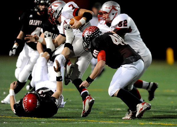 Fairview's Jeff Cunningham (40) helps to take down Grand Junction Central's quarterback Holden Reed (7) during the game at Recht Field  in Boulder, Friday, Nov. 6, 2009. <br /> KASIA BROUSSALIAN / THE CAMERA