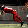 Fairview High School's Lucas Pena-Gonzalez (8) misses the catch with Northglenn High School's Michael Brito (19) close on his heels at Recht Field in Boulder, Friday, Oct. 16, 2009. <br />  DAILY CAMERA/ KASIA BROUSSALIAN