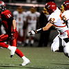Fairview High School's Tucker Tharp (11) runs in a touchdown ahead of Northglenn High School's Issac Munoz (52) and Sean Padilla (25) at Recht Field in Boulder, Friday, Oct. 16, 2009. <br />  DAILY CAMERA/ KASIA BROUSSALIAN