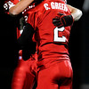 Fairview High School's Brandon Boyle celebrates with teammate Caleb Greer (2) after Boyle scored during the game against Northglenn High School at Recht Field in Boulder, Friday, Oct. 16, 2009. <br />  DAILY CAMERA/ KASIA BROUSSALIAN