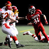 Fairview High School's Tucker Tharp (11) carries the ball on a kick return as a penalty is called during the game against Northglenn High School at Recht Field in Boulder, Friday, Oct. 16, 2009. <br />  DAILY CAMERA/ KASIA BROUSSALIAN