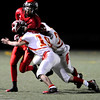 Fairview High School's Lucas Pena-Gonzalez (8) is taken down by Northglenn High School's Michael Brito (19) and Johnny Medina (33) at Recht Field in Boulder, Friday, Oct. 16, 2009. <br />  DAILY CAMERA/ KASIA BROUSSALIAN
