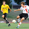 "Fairview High School's Ollie Gerland, right, dribbles the ball past Arapahoe's Ryan Beckman on Friday, Sept. 1, during a game against Arapahoe High School at Fairview. Fairview defeated Arapahoe 2-1. For more photos of the game go to  <a href=""http://www.dailycamera.com"">http://www.dailycamera.com</a><br /> Jeremy Papasso/ Camera"
