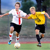 "Fairview High School's Ollie Gerland, left, tries to steal the ball from Arapahoe's Tyler Sloboth on Friday, Sept. 1, during a game against Arapahoe High School at Fairview. Fairview defeated Arapahoe 2-1. For more photos of the game go to  <a href=""http://www.dailycamera.com"">http://www.dailycamera.com</a><br /> Jeremy Papasso/ Camera"