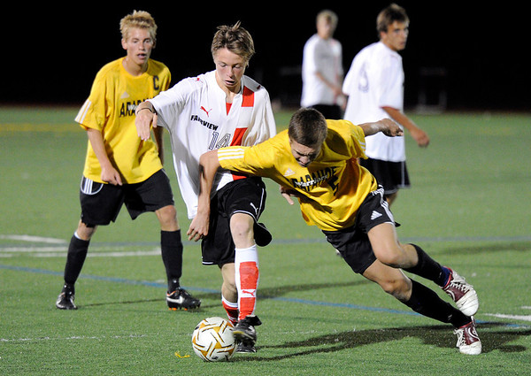 """Fairview High School's Darius Matthies, center, fights for the ball with Arapahoe High School's Aaron Avery on Friday, Sept. 1, during a game against Arapahoe High School at Fairview. Fairview defeated Arapahoe 2-1. For more photos of the game go to  <a href=""""http://www.dailycamera.com"""">http://www.dailycamera.com</a><br /> Jeremy Papasso/ Camera"""