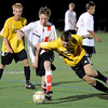 "Fairview High School's Darius Matthies, center, fights for the ball with Arapahoe High School's Aaron Avery on Friday, Sept. 1, during a game against Arapahoe High School at Fairview. Fairview defeated Arapahoe 2-1. For more photos of the game go to  <a href=""http://www.dailycamera.com"">http://www.dailycamera.com</a><br /> Jeremy Papasso/ Camera"
