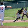 "Boulder Panthers Loic Guegan, attempts to steal while Fairview Knight's Johnny Feauto tries to get him out Saturday afternoon at Fairview High. The Panthers won 8-1. July 21, 2012. Rachel Woolf/ For the Daily Camera. For more photos of the game, go to  <a href=""http://www.bocopreps.com"">http://www.bocopreps.com</a>."