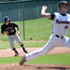 """Boulder Panthers Loic Guegan, attempts to steal while Fairview Knight's Johnny Feauto pitches Saturday afternoon at Fairview High. The Panthers won 8-1. July 21, 2012. Rachel Woolf/ For the Daily Camera. For more photos of the game, go to  <a href=""""http://www.bocopreps.com"""">http://www.bocopreps.com</a>."""