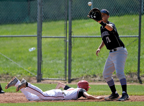 "Boulder Panthers Grant Rogers doesn't catch the ball in time to get Fairview Knights Ryan Madden out Saturday afternoon at Fairview High. The Panthers won 8-1. July 21, 2012. Rachel Woolf/ For the Daily Camera. For more photos of the game, go to  <a href=""http://www.bocopreps.com"">http://www.bocopreps.com</a>."