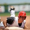 """Fairview Knights Johnathan Thorvilson slides back to 1st Saturday afternoon at Fairview High. The Panthers won 8-1. July 21, 2012. Rachel Woolf/ For the Daily Camera. For more photos of the game, go to  <a href=""""http://www.bocopreps.com"""">http://www.bocopreps.com</a>."""