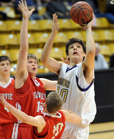 """Loren Ban of Boulder High scores past Jacob Lorentzen of Fairview.<br /> For more photos of the game, go to  <a href=""""http://www.dailycamera.com"""">http://www.dailycamera.com</a>.<br /> Cliff Grassmick / February 18, 2011"""