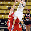 "Riley Grabau of Boulder puts up a shot over Bryce Dolan of Fairview.<br /> For more photos of the game, go to  <a href=""http://www.dailycamera.com"">http://www.dailycamera.com</a>.<br /> Cliff Grassmick / February 18, 2011"