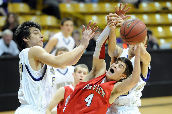 """Bryce Dolan (4) of Fairview, tries to gather in a rebound between Loren Ban, left, and Andre Rieder, both of Boulder High. Boulder won the game over Fairview  46-38.<br /> For more photos of the game, go to  <a href=""""http://www.dailycamera.com"""">http://www.dailycamera.com</a>.<br /> Cliff Grassmick / February 18, 2011"""