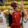 "Alec Pronk (41) of Fairview, tries to shoot between Chris Zeren, left, and Loren Ban, both of Fairview. Boulder won the game 46-38.<br /> For more photos of the game, go to  <a href=""http://www.dailycamera.com"">http://www.dailycamera.com</a>.<br /> Cliff Grassmick / February 18, 2011"
