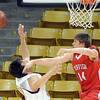 "Jacob Lorentzen of Fairview blocks the shot of Loren Ban of Boulder.<br /> For more photos of the game, go to  <a href=""http://www.dailycamera.com"">http://www.dailycamera.com</a>.<br /> Cliff Grassmick / February 18, 2011"