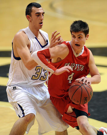 "Bryce Dolan of Fairview drives around Andre Rieder of Boulder.<br /> For more photos of the game, go to  <a href=""http://www.dailycamera.com"">http://www.dailycamera.com</a>.<br /> Cliff Grassmick / February 18, 2011"