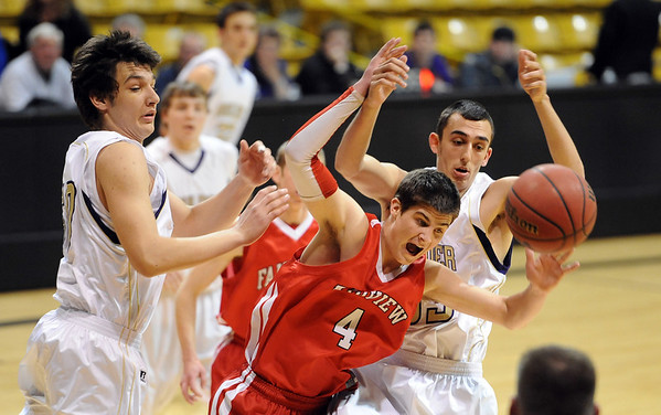 "Bryce Dolan (4) of Fairview, tries to gather in a rebound between Loren Ban, left, and Andre Rieder, both of Boulder High. Boulder won the game over Fairview  46-38.<br /> For more photos of the game, go to  <a href=""http://www.dailycamera.com"">http://www.dailycamera.com</a>.<br /> Cliff Grassmick / February 18, 2011"