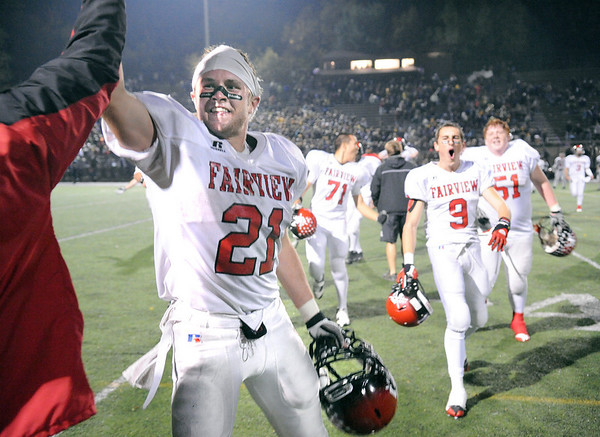 Fairview High School senior Brian Sture gives a high five on Friday, Oct. 22, after defeating Boulder High School 10-7 in a football game at Recht Field. Fairview defeated Boulder 10-7<br /> Jeremy Papasso/ Camera