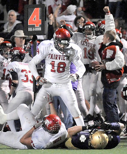 Fairview High School junior Jack Madden yells in the face of a Boulder High School player after stopping a fourth down attempt late in the fourth quarter of the football game on Friday, Oct. 22, at Recht Field. Fairview defeated Boulder 10-7 Jeremy Papasso/ Camera