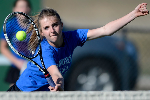 Broomfield's Shavaun Wood hits the ball at the net in doubles agains Fairview during their tennis match at Broomfield Swim and Tennis Club in Broomfield, Colorado March 20, 2012.   CAMERA/MARK LEFFINGWELL